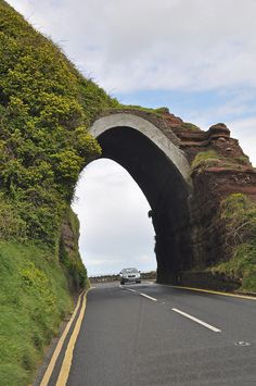 The arch at Red Bay, Antrim Coast Road, Northern Ireland. Ireland Uk, Ireland Travel, Northern Ireland, Beautiful Islands, Beautiful Places, Scottish English, Places To Travel, Places To Visit, Emerald Isle