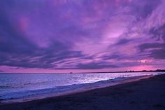 lavender clouds over the ocean