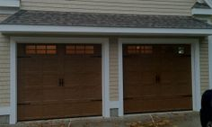I don't think you can sell me on any garage door that doesn't look wooden like this. Also it has the windows that I love!I really like the warm light that you can see peeking out of those windows.