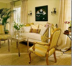 an antique French side table is used instead of a modern coffee table.