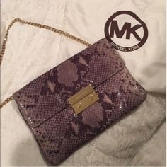 MICHAEL Michael Kors Sloan clutch From nightclub to dinner party, this gorgeous gray with gold hardware Michael Kors evening bag will be a staple in your closet. Minimal signs of wear including some small scratches on gold closure and super light wear on outer corners. Interior slots can hold up to 6 cards, plus 2 interior pockets and one zip closure. Perfect for upcoming holiday parties! Michael Kors Bags Shoulder Bags