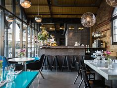 The Dock Kitchen offers a modern, experimental menu in converted wharf building with open decor.