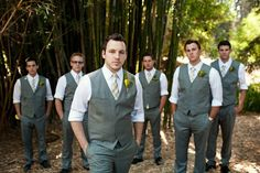 "one of my favorite groomsmen shots- I said ""stand like a band"" - with grey vests, rustic billy ball boutonnieres  www.frenzelstudios.com"