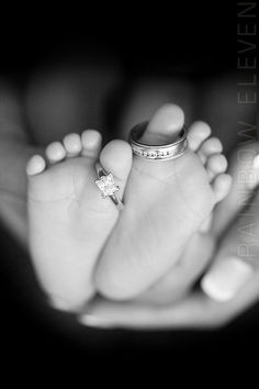 Baby's feet with mommy and daddy's wedding rings♥