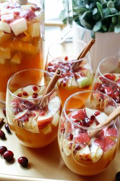 This Fall Harvest Sangria is the perfect holiday cocktail filled with crisp apples, pears, cranberries, cinnamon sticks and fresh apple cider! Drinks Fall Harvest Sangria - Eat Yourself Skinny