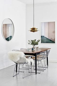 The fantastic home of a creative Finnish duo. Metal Chairs look good, but can be uncomfortable. Adding a sheepskin takes care of that problem.