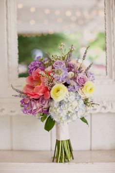 Lovely bouquet, I would just use softer colors :)