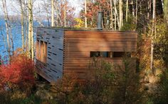 Sunset Cabin is a 275-square foot lake retreat that's camouflaged with a green roof and cedar-slat facade. Designed by Taylor Smyth Architects