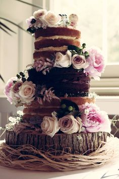 Naked wedding cake, three flavoured sponges dressed with fresh flowers. #lilmisssadiecakes