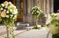 The overflowing white flowers at the entrance of St. Wedding Flower Packages, Wedding Ceremony Flowers, Floral Wedding, Wedding Receptions, Church Wedding Decorations, Ceremony Decorations, Church Weddings, Wedding Church, Real Weddings