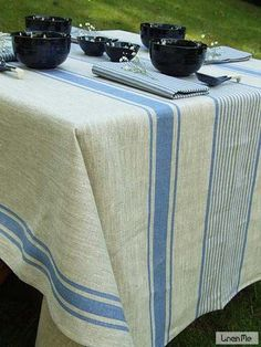 Blue Linen Provence Tablecloth Blue stripes over natural grey colour shade backround. This wonderful mix of blue and natural linen colours produces a French-style tablecloth, ideal for both formal and