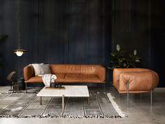 Rondo Max Leather sofa by MOLINARI DESIGN, Travertine coffee table by TEN10