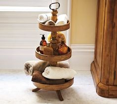 what a cute way to store bathroom stuff. Great for a guest bathroom