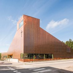 Copper covers walls and roof of Finnish chapel by OOPEAA