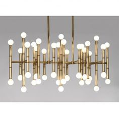 Modern Bamboo The Meurice Collection: Poised and ready to transform your abode, flatter your features and chic-ify your life! The Meurice Chandelier adds sculptural glow in a narrow hallway or above a dining room table.