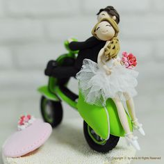 A cute couple on the bike (vespa) wedding cake topper by Anna Crafts | via Flickr