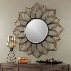 Cheerful, Sunflower Design Made Of Hand Forged Iron, Encase The Beveled Mirror. Frame Features An Antiqued Metallic Gold Finish With Heavy Black Dry Brushing Creating An Ombre Effect.Dimensions: x x Materials Used: IRON, MIRROR ,MDFArtist: Billy Moon Round Wall Mirror, Wall Mounted Mirror, Beveled Mirror, Wall Mirrors, Rustic Mirrors, Rustic Wall Decor, Vases, Uttermost Mirrors, Barn Wood Picture Frames