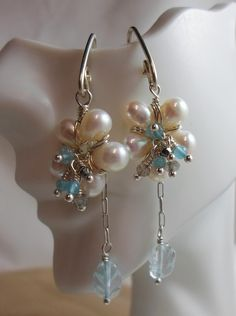 Check out this item in my Etsy shop https://www.etsy.com/listing/221380388/flowers-wire-wrapped-pearl-earrings-w