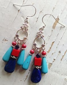 Artisan handmade silver chandelier earrings with lapis and turquoise teardrops, violet purple crystal, and red coral and pearl, 2 1/8 inches plus 1/2 inch silver plated ear wires These vibrant southwest gemstones will compliment your favorite dress or your most comfortable jeans.