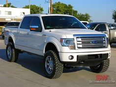 white lifted ford f-150 truck