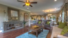 Goodall Homes @ Fairvue Plantation. Interior design by ShopGirl. Living Space with furniture by Classic Home and Silk Route