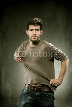 Pulling his tshirt for creating copy space