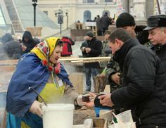 Humans of Ukraine's #Euromaidan Protests - An elderly woman pouring hot tea to protesters.
