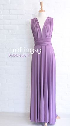 Bridesmaid dresses FOUND. Thinking of a lace overlay for the MOH and a Chiffon overlay for the bridesmaids to fancify it a bit. Criss-cross style for MOH and one-shoulder for BMs.