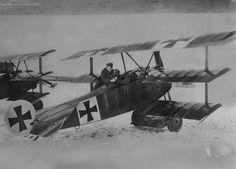 World War I German flying ace Baron von Richthofen with one of his Triplanes.