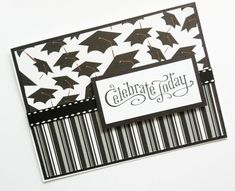 Classy handmade graduation card with 2 strips of specialty paper and a printed smaller card on top of a ribbon stripe.
