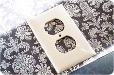 Covered Light Switch & Outlet Plates with scrapbook paper and modge podge. Very smart!