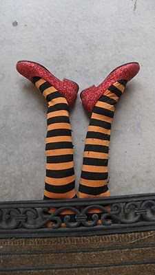 Okay, this is just too fun! A pair of tights, a pair of shoes and some stuffing  and you have yourself a really fun way  to add some fun to your front porch!