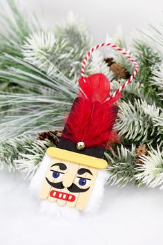 Nutcracker Craft - Use popsicle sticks, paint, feathers, and faux fur to create this original nutcracker ornament for kids! Nutcracker Crafts, Nutcracker Ornaments, Christmas Ornament Crafts, Nutcracker Christmas, Christmas Decorations To Make, Handmade Christmas, Holiday Crafts, Christmas Diy, Diy Ornaments