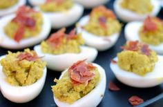 Mayo Free Deviled Eggs |  These two bite (or one big bite) treats are the perfect mini snack for any type of gathering. @realsimplegood