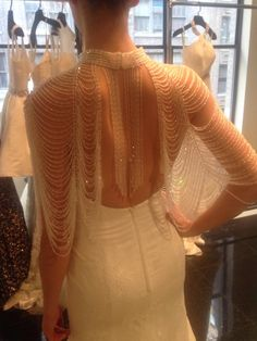 Love this exquisite Simone Carvalli Gatsby inspired capelet!  #wedding #weddinggown #BridalReflections