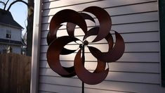 Costco Metal Wind Spinner Kinetic Garden Sculpture. Bought one like this at Costco. Great buy!!!! Wish I'd bought 2.