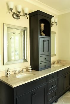 cabinet between sinks in master- I want to do this....not in these colors, but it's what I have in mind! builder grade mirror be damned!