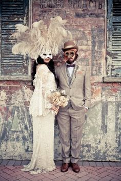 New Orleans Masquerade Wedding ~ a little much for me but I love the idea peacock feathers <3