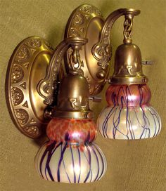 Materials Unlimited - 609693 -Pair of Antique Colonial Revival Wall Sconces with Loetz, $1,550.00 (http://www.materialsunlimited.com/609693-pair-of-antique-colonial-revival-wall-sconces-with-loetz/)