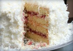 Coconut Cake with Raspberry Filling Preface: Before you look at the list of ingredients in this cake stop. The cake is really really easy to prepare. Use whatever frosting youd like but try the cake After a weekend of Coconut Cake With Raspberry Filling Recipe, Rasberry Filling, Raspberry Frosting, Red Raspberry, Cupcakes, Cupcake Cakes, Just Desserts, Delicious Desserts, Yummy Food