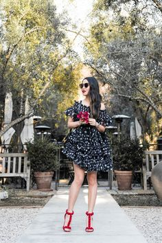 A polka dot minidress that can be worn multiple ways! Off the shoulder, one shoulder, low boat neckline, the possibilities are endless!