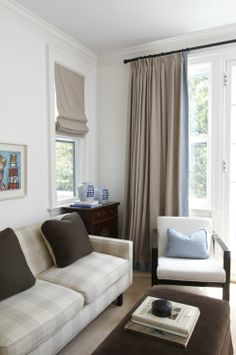 Love this for my living room.. I would do the romans over the small windows, and long drapes over the picture window. It's very masculine, but I could girly it up.