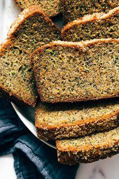 Lemon Poppyseed Zucchini Bread with zucchini, brown sugar, zested lemons, olive oil, ginger, and poppyseeds. The most healing breakfast or snack! #zucchini #zucchinibread #snackcake Lemon Zucchini Bread, Lemon Bread, Apple Recipes, Sweet Recipes, Bread Recipes, Fall Recipes, Scones, Lemon Olive Oil Cake, Biscuits