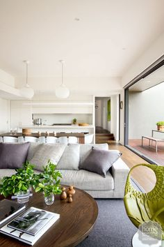After exploring a multitude of renovation options, a Melbourne family decided all they really needed was one big room.