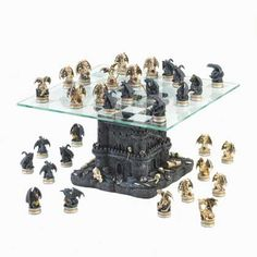 """The battle for ultimate rule of the kingdom: cold-blooded dragons versus bloodless dragons! On a glass chess board resting atop a war-ravaged castle strewn with the remains of battles gone, this chess set will inspire fire-breathing contests of wit and strategy. A must-have for collectors and chess wizards.  Item weight: 8.4 lbs. 11 5/8"""" x 11 5/8"""" x 7¼"""" high; base is 7½"""" square x 7"""" high; tallest piece is 2 1/8"""" high; smallest piece is 1¾"""" high. Polyresin and glass. May Require Additional…"""