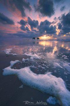 ~~The Arch of Rockaway • sea foam and intense winds sweep the beach at sunset, Rockaway Beach, Coastal Oregon • by Brian Adleberg~~