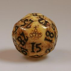 English carved marine ivory teetotum (lottery) gambling ball. etched with a crown & Incised on 32 sides with the numbers 1 to 31.  5cm diameter.