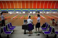 Let's Roll: Girls play inside a Pyongyang bowling alley. (TOMAS VAN HOUTRYVE)