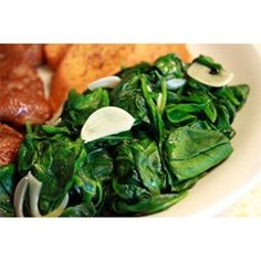 Quick and Easy Sauteed Spinach.  I asked Google 'How to cook spinach' and this was the first suggestion. 15 minutes later I was ready to server this spinach to my family.