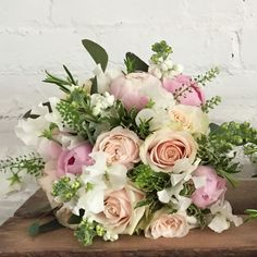 Summer bridal bouquet created for Farnham Castle Bride by Eden Blooms Florist from Sweet Avalanche Rose, Green Bell, Rosemary, White Sweetpea, Alerti Peony, White Stock, David Austin 'Kiera' Rose, White 'O'Hara Rose & Eucalyptus.